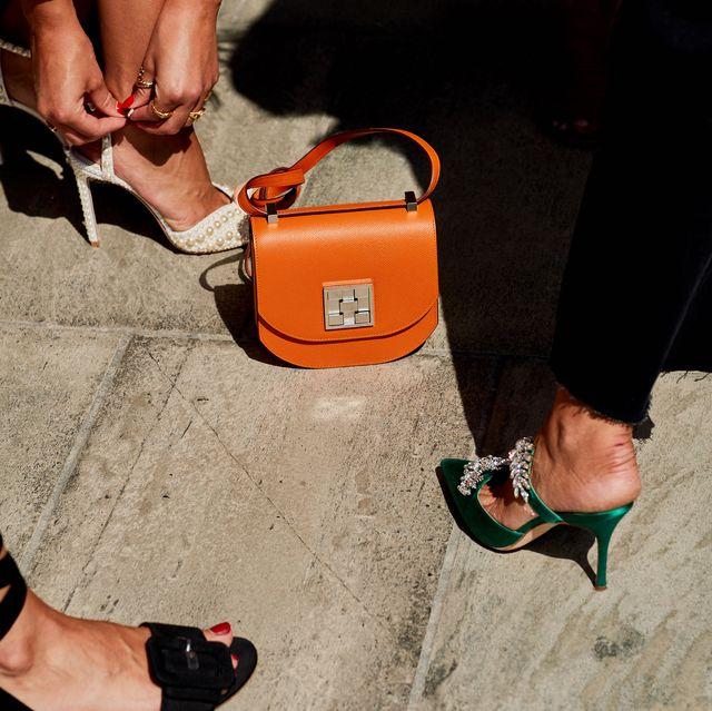 Footwear, Red, Leg, Human leg, Shoe, Yellow, Orange, Street fashion, Fashion, Foot,