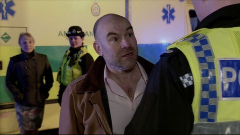 tim metcalfe speaks to the police in coronation street