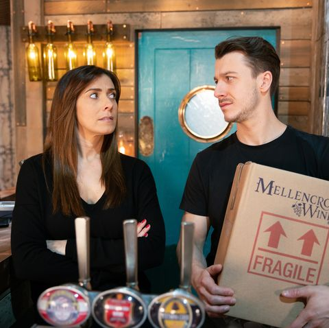 Michelle Connor drags Ryan into a shot on Coronation Street