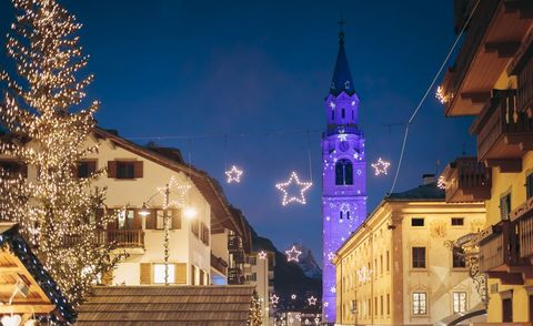Sky, Town, People, City, Night, Landmark, Public space, Human settlement, Lighting, Town square,