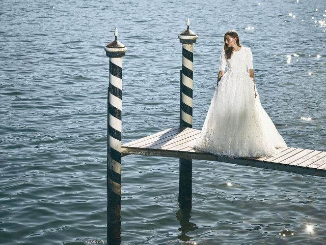 Water, Photograph, Bride, Wedding dress, Dress, Bridal clothing, Sea, Gown, Happy, Ceremony,