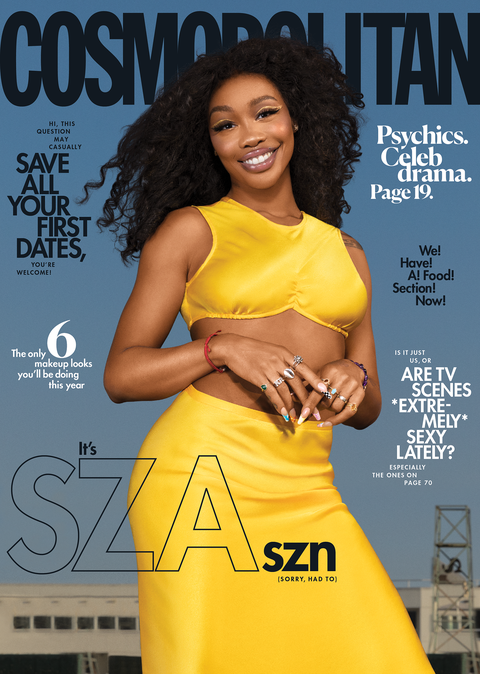 february 2021 cosmopolitan cover of singer sza, wearing a yellow gold top and skirt in front of a city background
