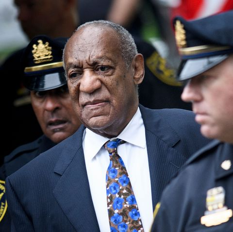 cosby in a suit on the way to court