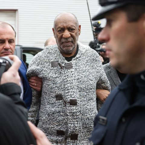 cosby in a grey sweater being arrested