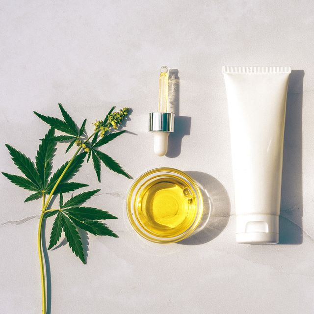 cosmetics cbd oil cosmetic products with cannabis oil tincture flat lay