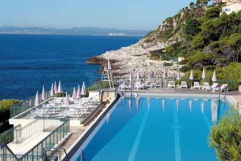 Swimming pool, Property, Azure, Coast, Resort town, Sea, Vacation, Resort, Building, Bay,
