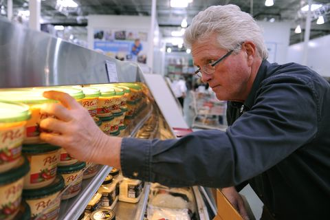 costco employee randy moe stocked grocery items at the store at 4000 river point parkway in sheridan friday afternoon, october 28, 2011 karl gehring