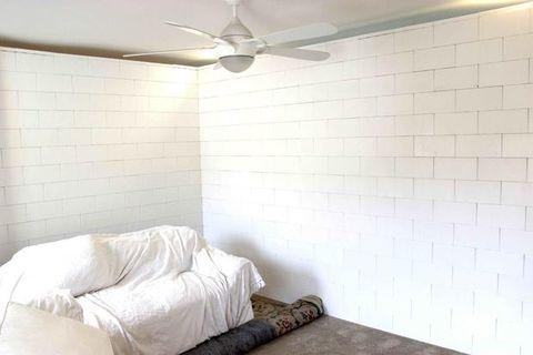 Room, Ceiling fan, Interior design, Property, Wall, Floor, Ceiling, Flooring, Mechanical fan, Linens,