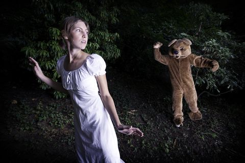 Costumed Bear Chasing A Young Woman
