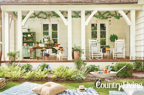 pretty front porch with a dog and rocking chairs