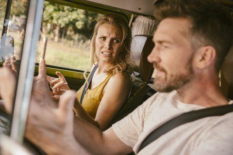 Couple arguing in van on a road trip