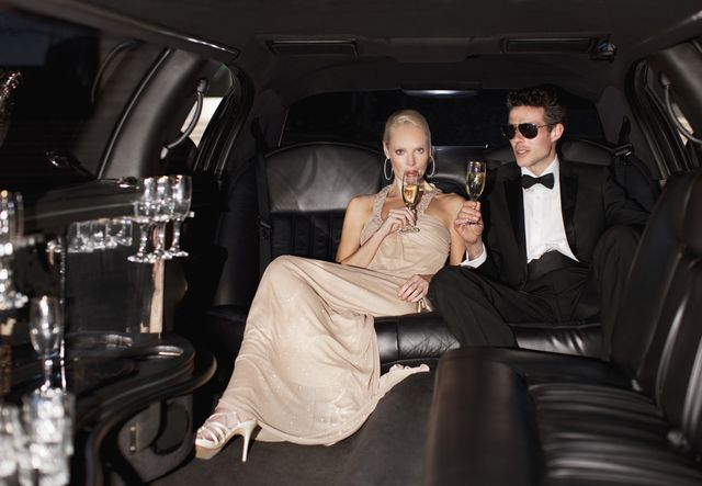 couple drinking champagne in limo