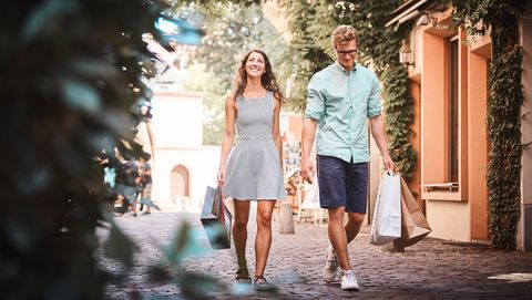 Couple enjoy moments together in urban setting