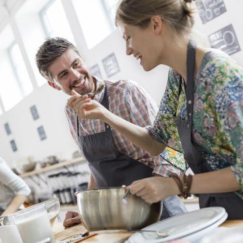 winter date ideas - Couple enjoying cooking class kitchen