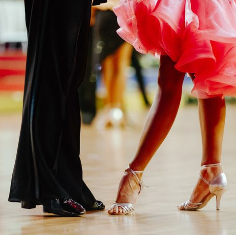 couple feet of dancers, woman and man latino dancing