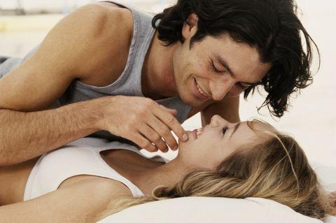 COUPLE HAVING FUN INSIDE KISSING