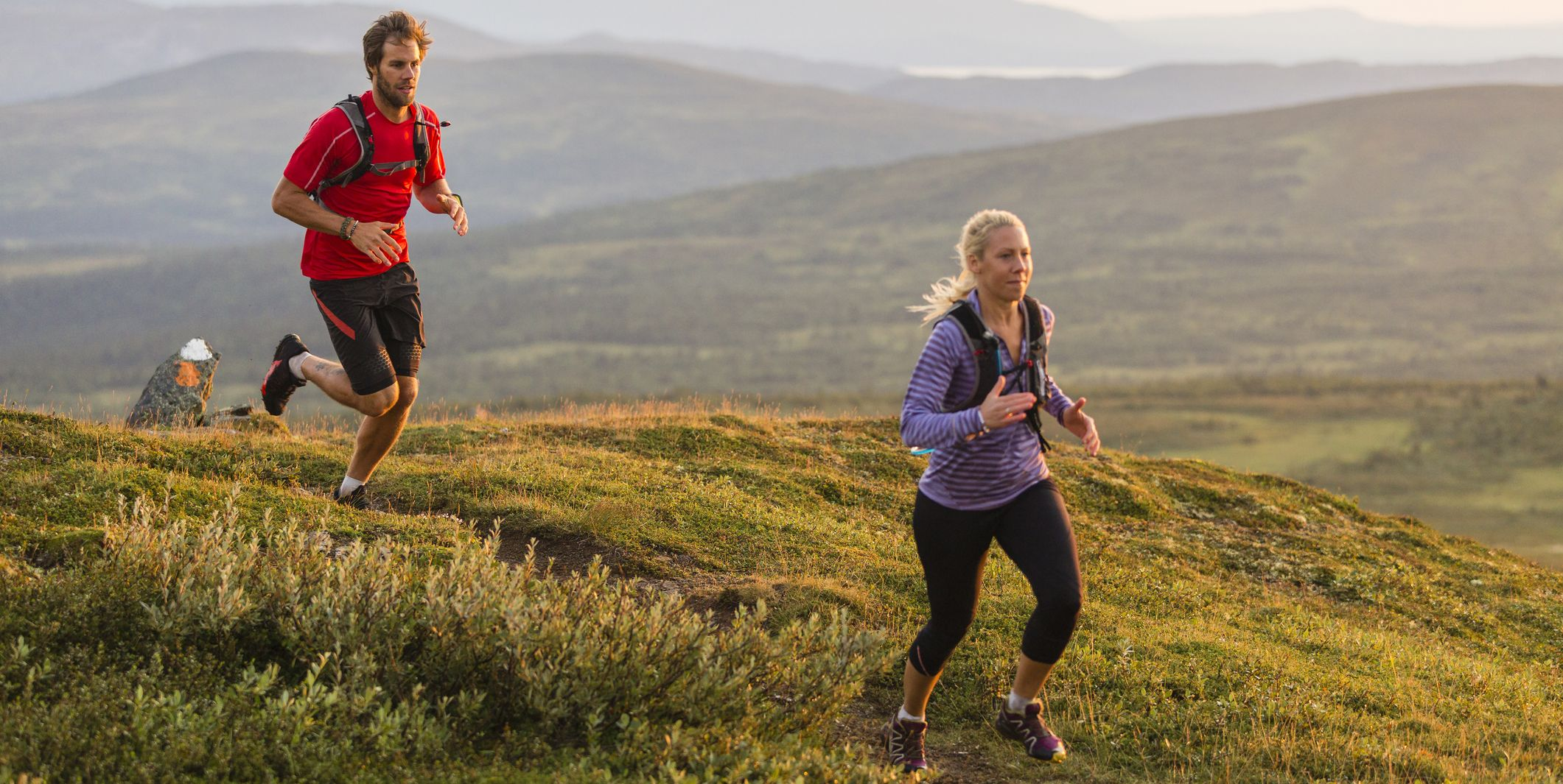 Couple jogging in mountains