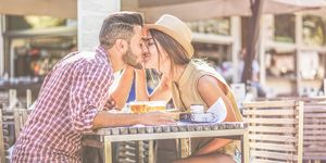 Couple Kissing At Cafe