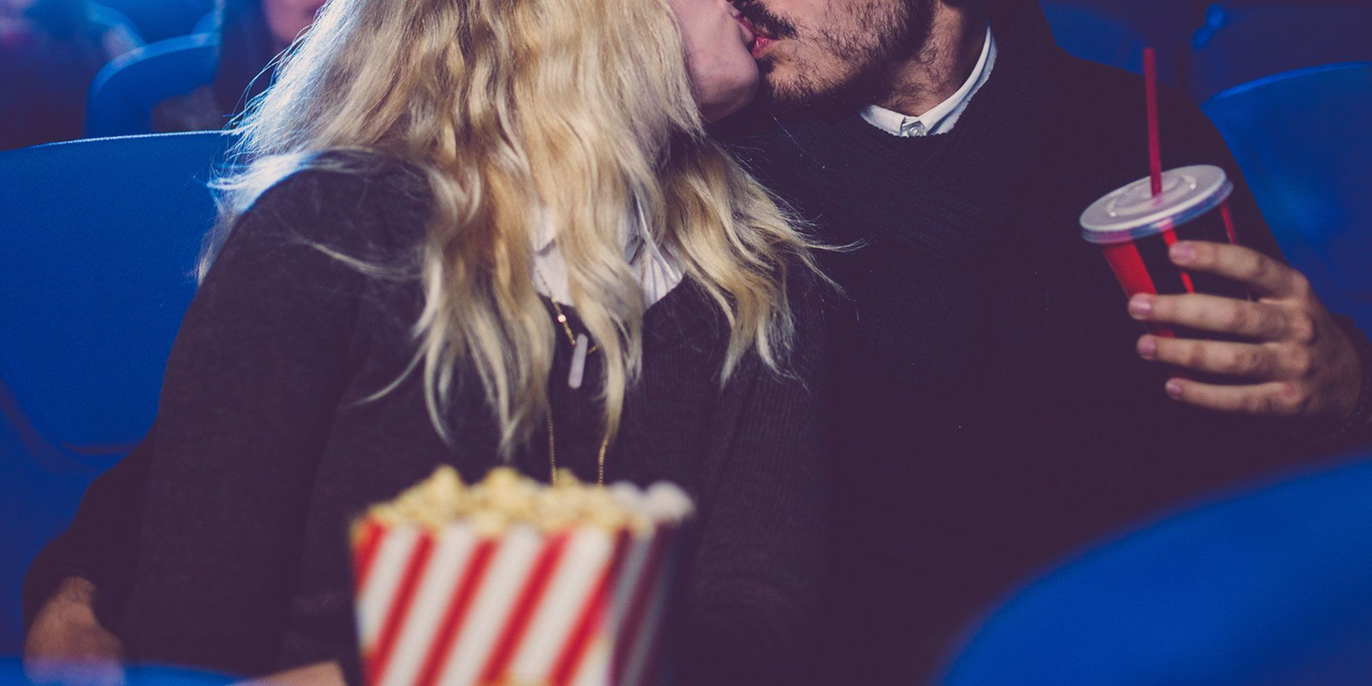Couple kissing in the cinema