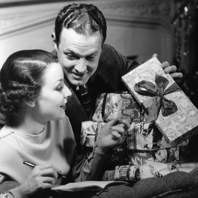 couple looking at christmas gifts