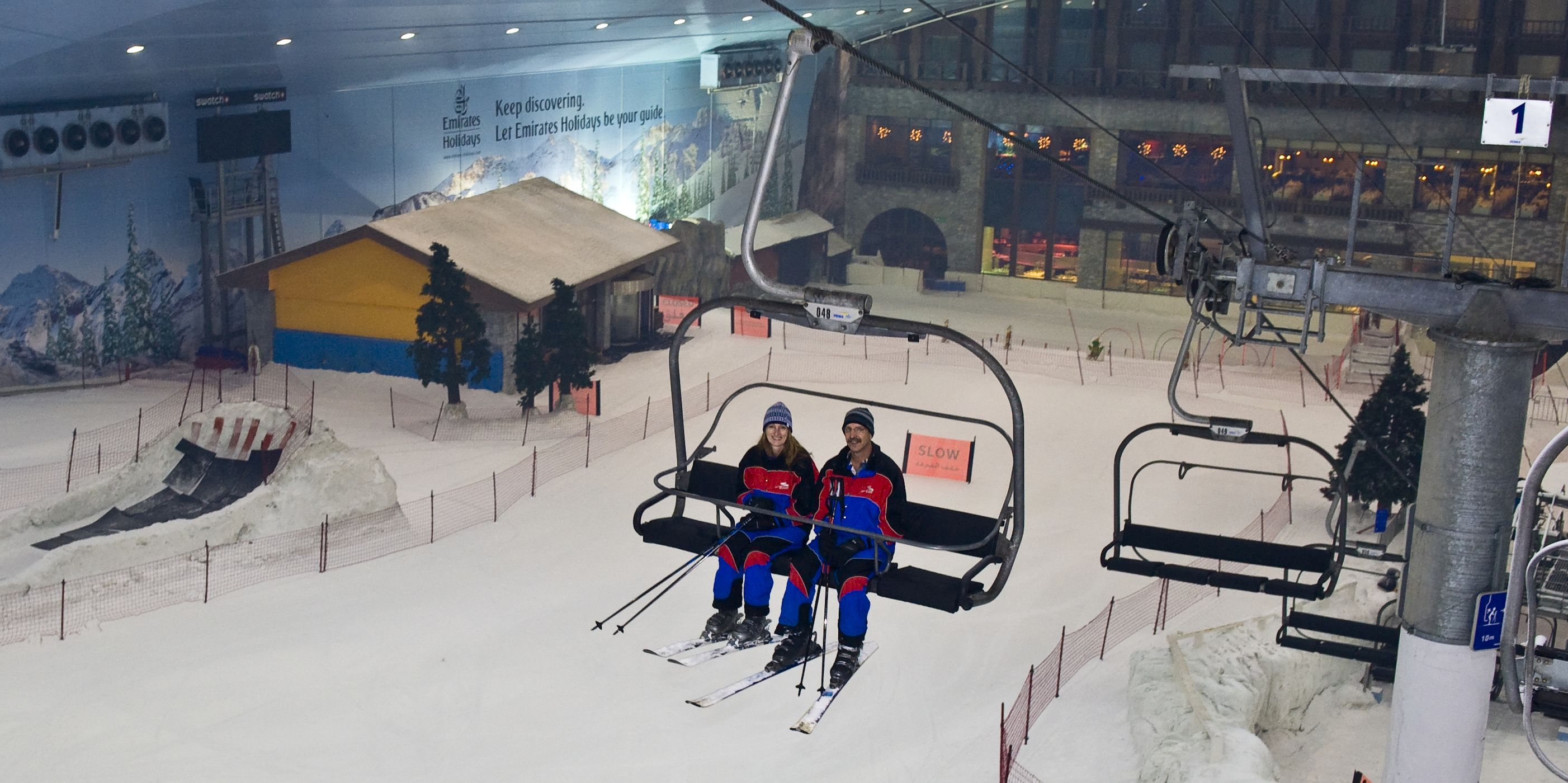 Couple on a chair lift at Ski