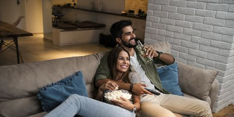 Couple on Sofa Watching TV