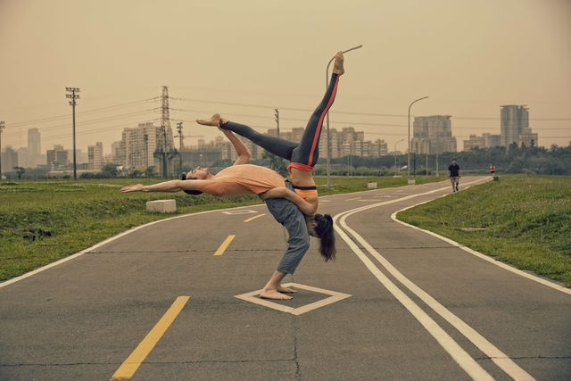 a couple performs acroyoga the exercise a blend of