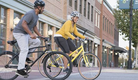 Couple Riding Bicycles in City