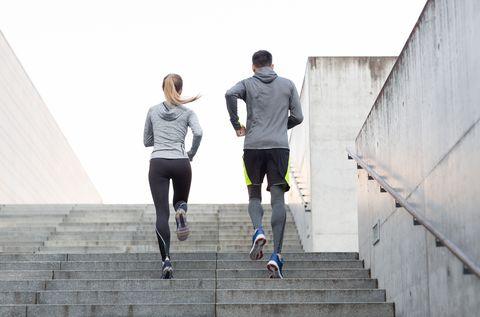 couple running upstairs on city stairs