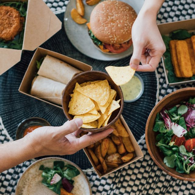 couple sharing takeaway food at home