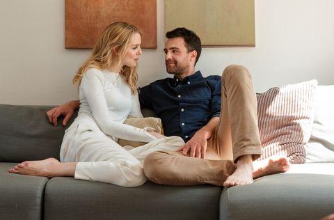 Couple snuggling on sofa