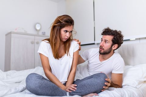 couple with problems having disagreement in bed frustrated couple arguing and having marriage problems, young couple into an argument on bed in bedroom