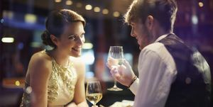 Couple with wine glasses in restaurant