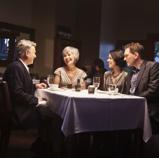 couples enjoying dinner in restaurant together
