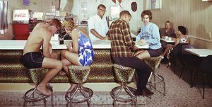 Couples Enjoying Refreshments at Safari Motel Coffee Shop