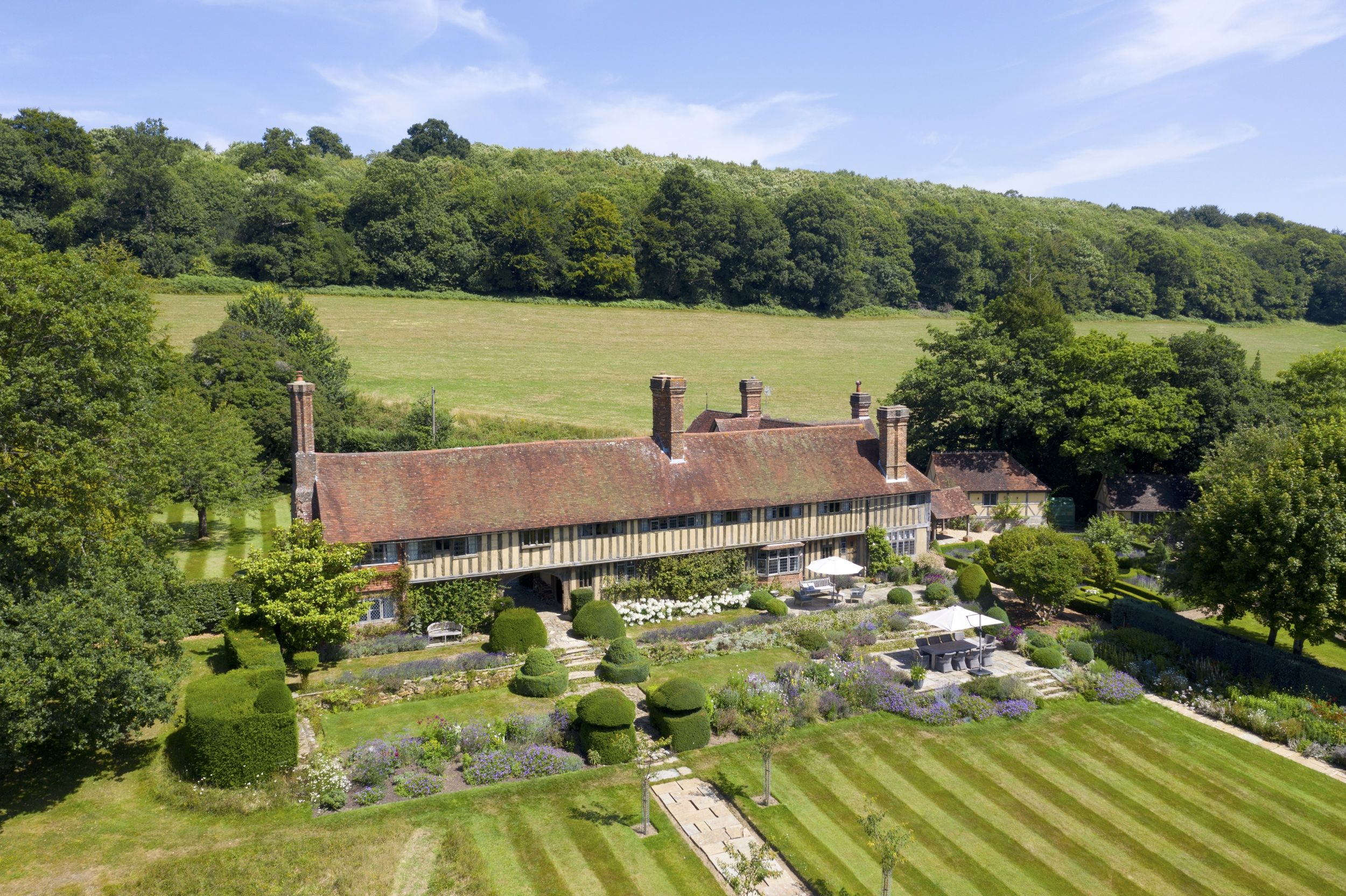 See inside this magnificent medieval home with Arts and Crafts garden