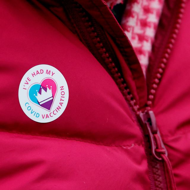 person wearing a covid vaccination sticker on their jacket