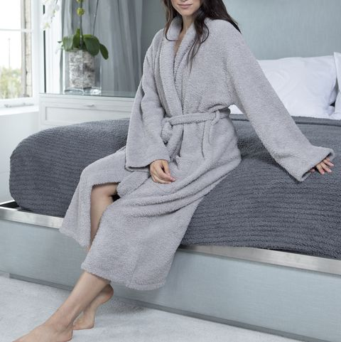 Clothing, Nightwear, Robe, Pajamas, Outerwear, Leg, Dress, Sleeve, Neck, Sitting,
