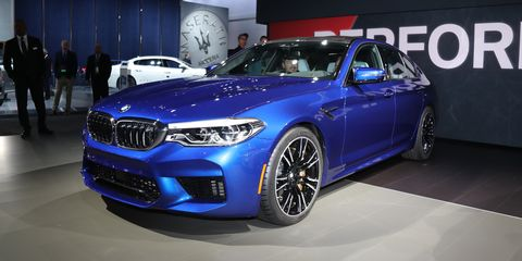 Land vehicle, Vehicle, Car, Luxury vehicle, Blue, Auto show, Personal luxury car, Bmw, Motor vehicle, Performance car,