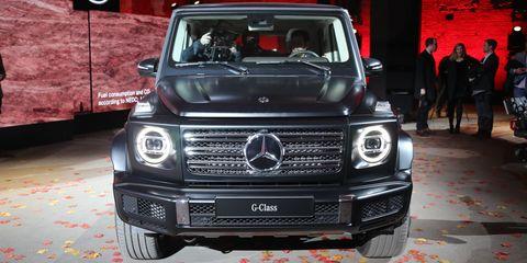 Land vehicle, Vehicle, Car, Mercedes-benz g-class, Motor vehicle, Sport utility vehicle, Grille, Mercedes-benz, Luxury vehicle, Automotive design,