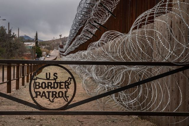 topshot   a metal fence marked with the us border patrol sign prevents people to get close to the barbedconcertina wire covering the usmexico border fence, in nogales, arizona, on february 9, 2019 photo by ariana drehsler  afp        photo credit should read ariana drehslerafp via getty images