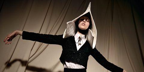 Hand, Standing, Formal wear, Costume accessory, Acting, Costume design, Costume, Waist, Performance art, Drama,