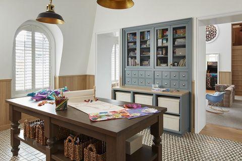Room, Interior design, Furniture, Table, Wall, Interior design, Light fixture, Flooring, Lampshade, Teal,