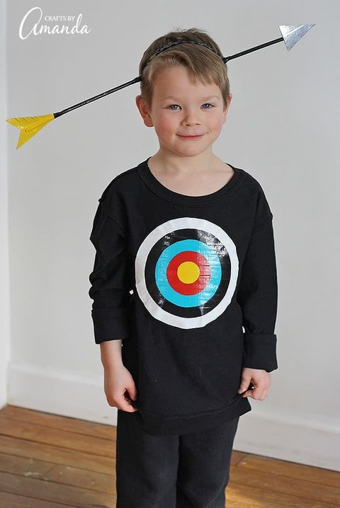 little boy wearing bullseye shirt with fake arrow through head
