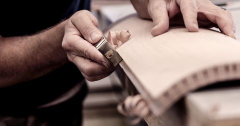 Craftsperson using hand tools, close up
