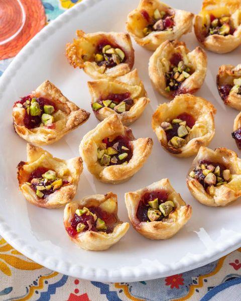 cranberry brie bites on white platter