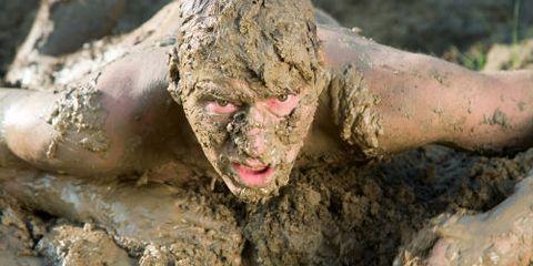 Guy Crawling in Mud