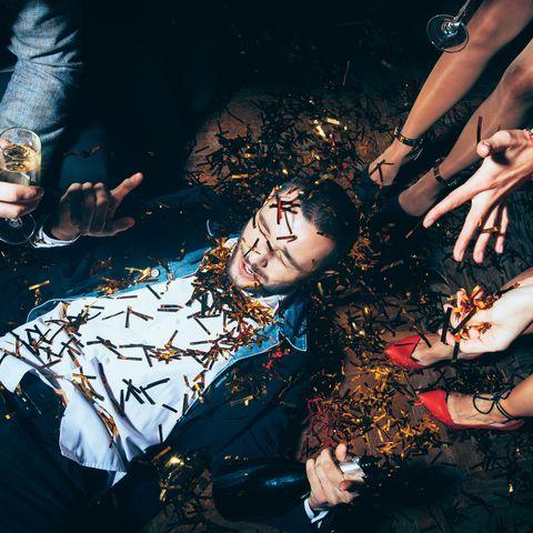 Crazy party. Drunk man lying on floor