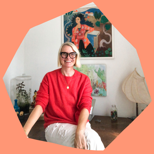 liz gilbert sitting on her desk in her personal home office