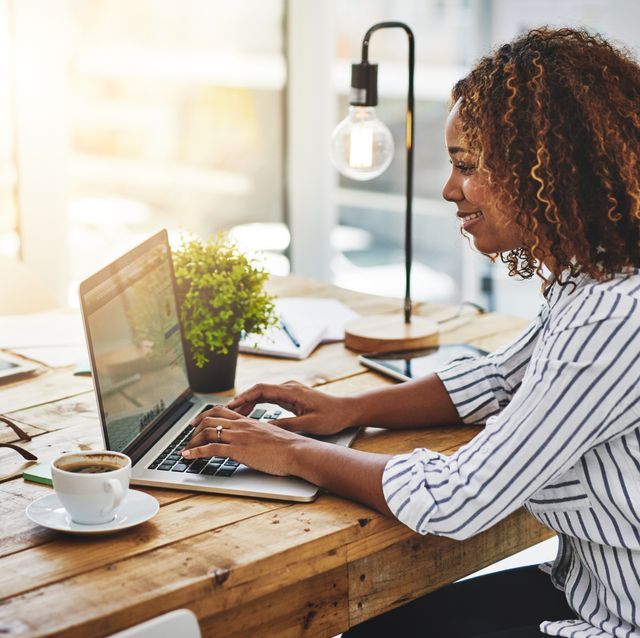 side hustle ideas - woman at computer